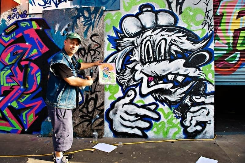 Graffiti artist showing concept and finished product