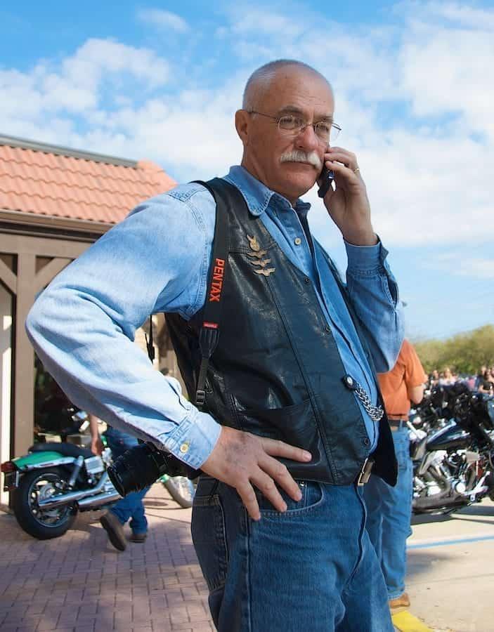 Portrait of biker at Daytona Bike Week on cell phone