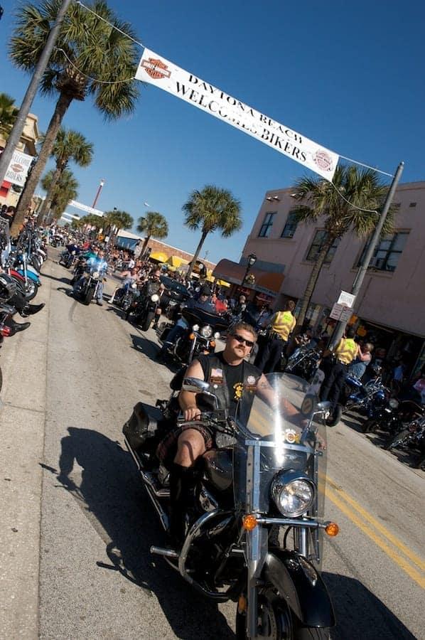 Biker rides on Main Street during Daytona Bike Week
