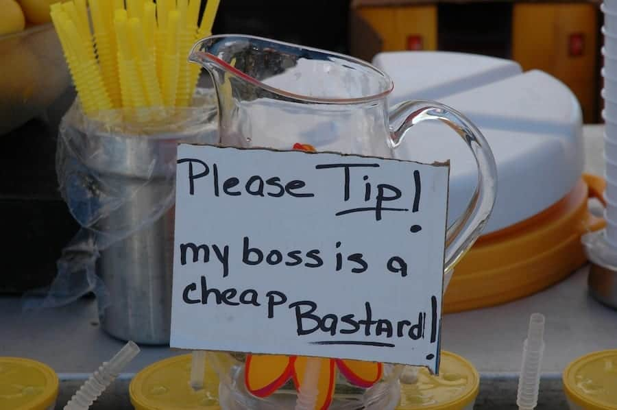 Sign on pitcher encouraging tips