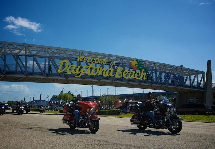 Bike Week motorcycles under the Welcome to Daytona Beach sign