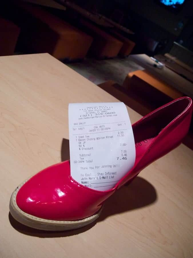 Hamburger Mary's guest check arrives in red high heel shoe