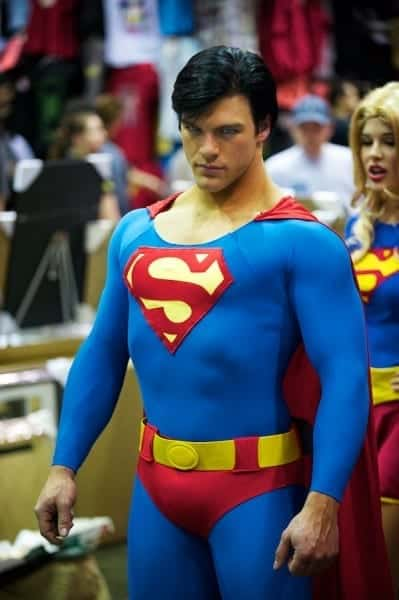 Superman at MegaCon, with Supergirl admiring from behind